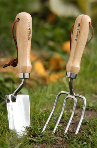 Stainless hand trowel with wooden handle