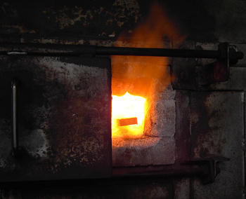 Steel is heated in the furnace.