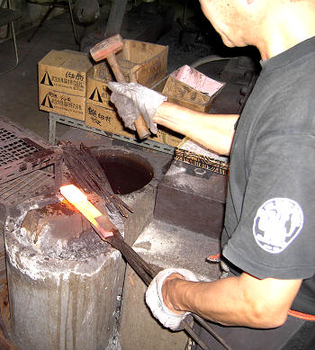 After reheating the metal in the furnace, Kitaoka will forge the layers together by hand.