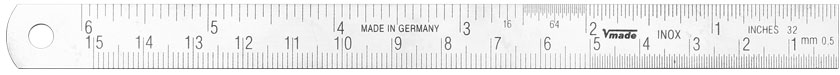 Steel rule made in Germany, to read from the right to the left;  inch-graduation on the first edge, mm-graduation on the second edge, backside plain, flexible.